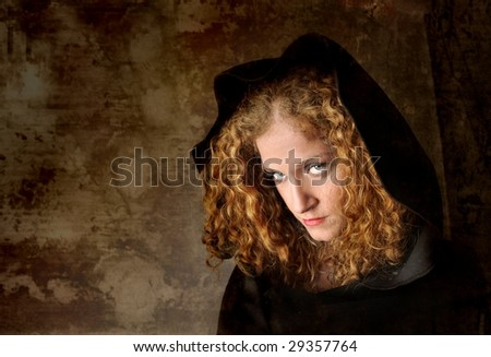 beautiful girl in a black mantle - stock photo