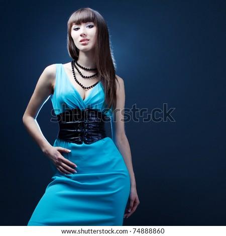 beautiful girl in a blue dress - stock photo