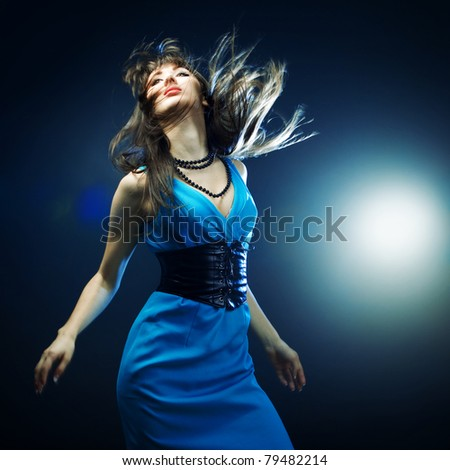 beautiful girl in a blue dress - stock photo