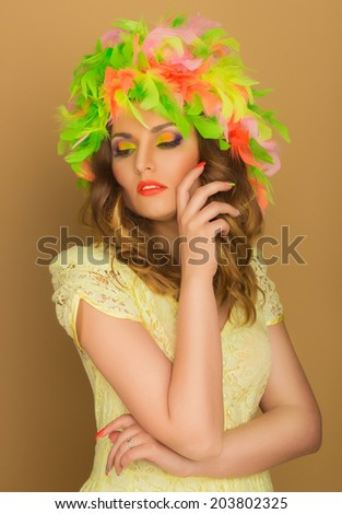Beautiful girl in a bright wig against the background