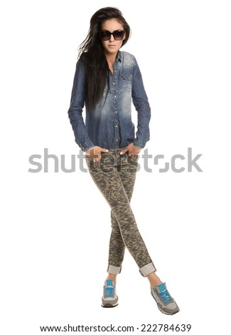 beautiful girl in a denim shirt and jeans on white background