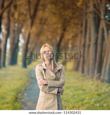 beautiful girl in a dress in autumn - stock photo