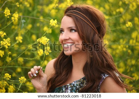 Beautiful Girl in a Flower Field. Image is Slightly Soft.