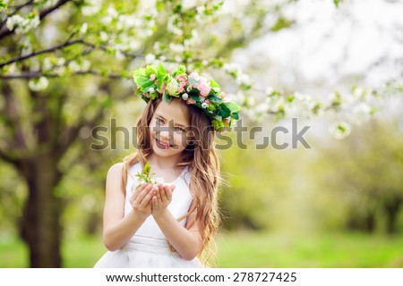 beautiful girl in a flowering garden - stock photo