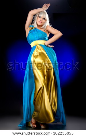 beautiful girl in a flying dress - stock photo