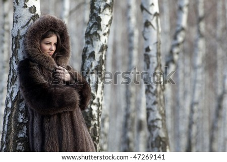 beautiful girl in a forest of birch - stock photo