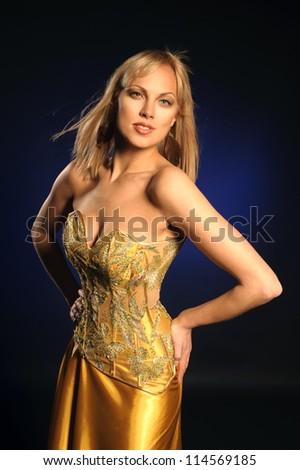 beautiful girl in a gold corset - stock photo