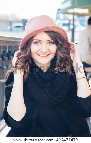 Beautiful girl in a hat
