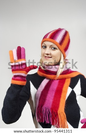 beautiful girl in a hat and gloves on the background - stock photo