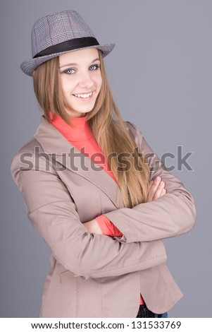 Beautiful girl in a hat smiling - stock photo