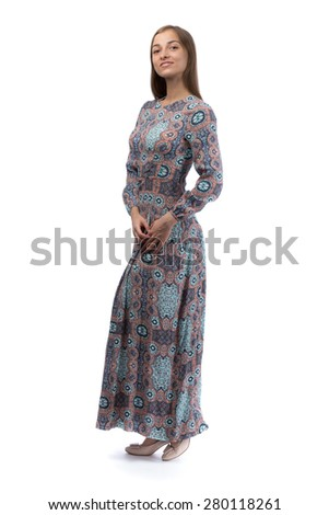 Beautiful girl in a long blue dress in the studio. Isolate on white. - stock photo