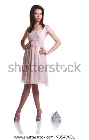 beautiful girl in a pink dress with a handbag on a white background - stock photo