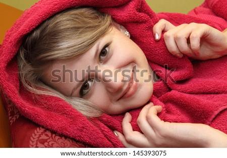 beautiful girl in a red bathrobe - stock photo