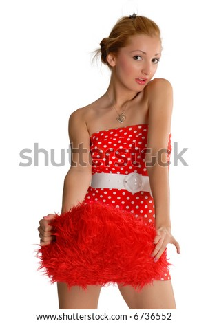 Beautiful girl in a red dress with a big red heart shape pillow