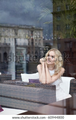 Beautiful girl in a restaurant in a glass - stock photo