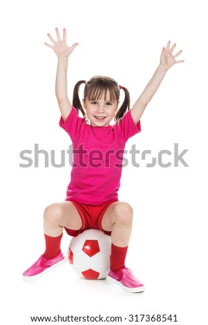 Beautiful girl in a sports T-shirt with a ball on a white background. - stock photo