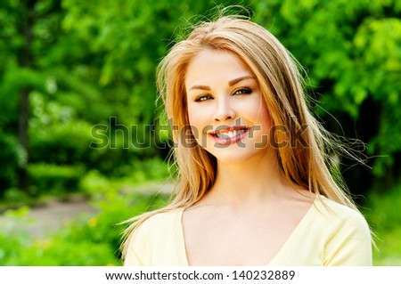 beautiful girl in a summer park - stock photo