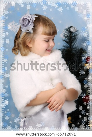 beautiful girl in a white coat around a Christmas tree