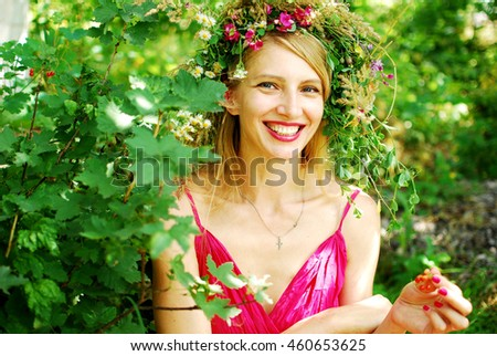 beautiful girl in a wreath from dandelions