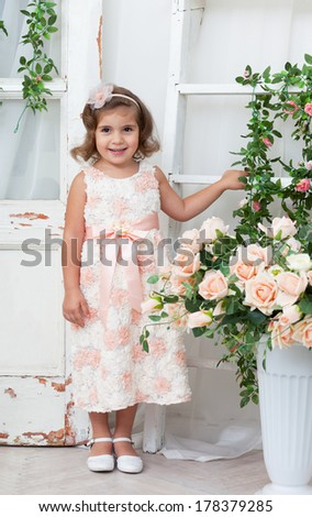beautiful girl in an elegant dress with flowers