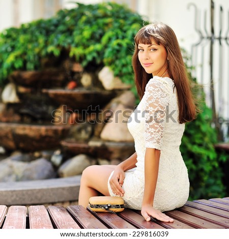 Beautiful girl in an old town - stock photo