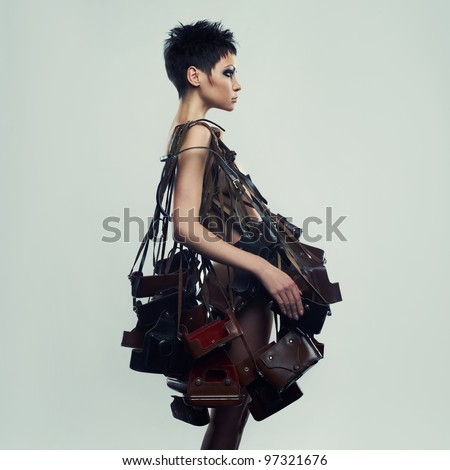 Beautiful girl in an unusual dress of the old photo cases - stock photo