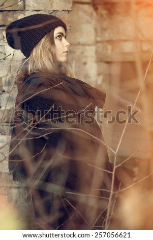 Beautiful girl in autumn day watching the sunset.