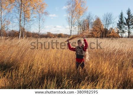 beautiful girl in autumn park - stock photo