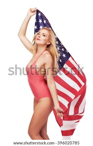 Beautiful girl in bikini holding the USA flag - stock photo