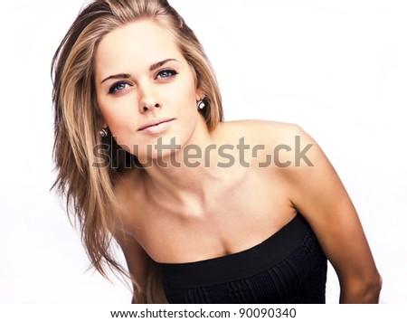 Beautiful girl in black classical dress. - stock photo