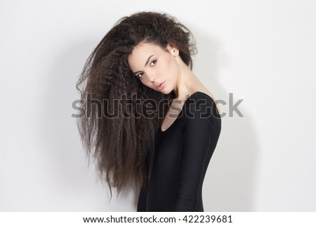 beautiful girl in black gymnastic suit. healthy hair young woman - stock photo