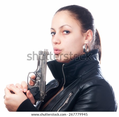 Beautiful girl in black leather jacket and beretta gun in her hands isolated on white background. - stock photo
