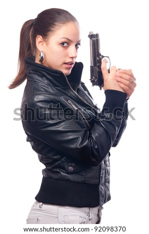 Beautiful girl in black leather jacket and beretta gun in her hands isolated on white background - stock photo