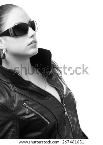 Beautiful girl in black leather jacket and sunglasses isolated on white background.