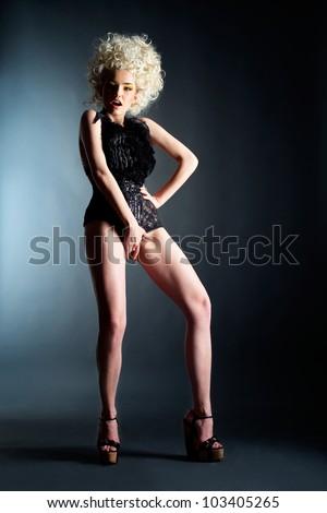 Beautiful girl in black lingerie - stock photo