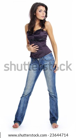 Beautiful girl in blue jeans - stock photo