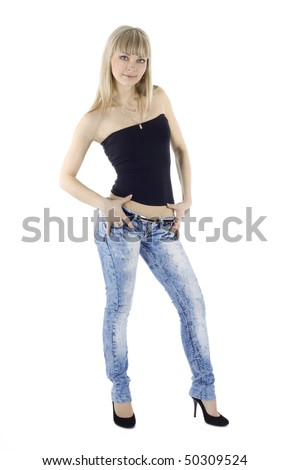 Beautiful girl in blue jeans, isolated - stock photo