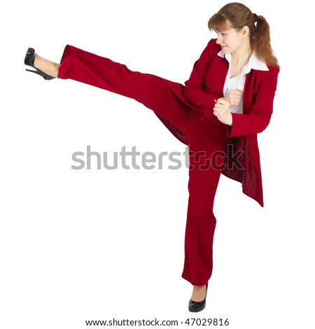 Beautiful girl in business suit kicks, isolated on a white background