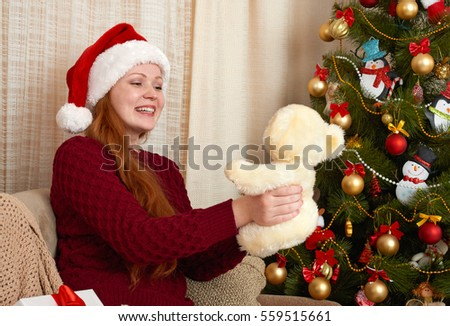 Beautiful girl in christmas decoration at home. New year eve and winter holiday concept.