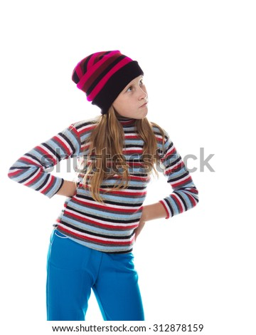 Beautiful girl in colored striped hat and sweater on a white background. - stock photo