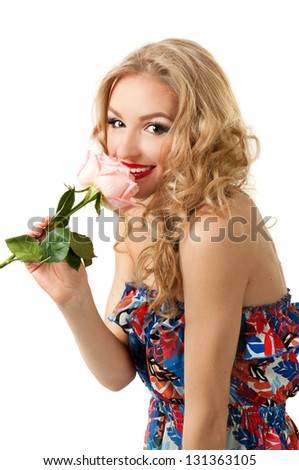Beautiful girl in colorful retro dress  standing with pink rose isolated on white - stock photo