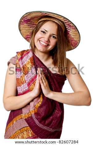 Beautiful girl in Conical Asian hat poses in studio isolated on white. smile - stock photo
