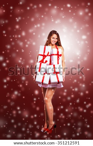 beautiful girl in costume of Santa Claus with shopping at the Ch