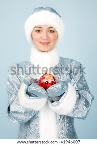 Beautiful girl in costume with new year toy - stock photo