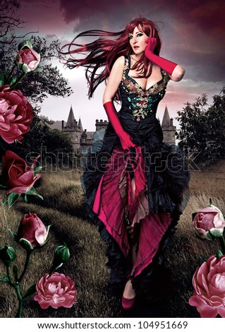 beautiful girl in evening dress running through a meadow with roses - stock photo