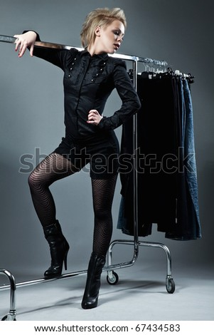 beautiful girl in fashion clothes in the dressing room - stock photo