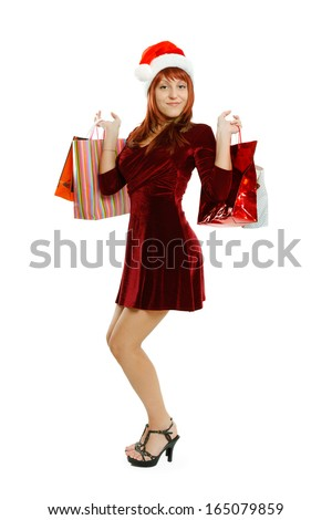 Beautiful girl in full growth with gift bags - stock photo