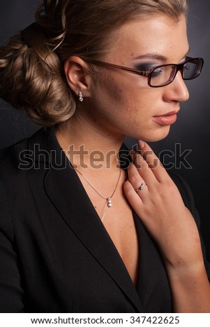 beautiful girl in  glasses and jewelry
