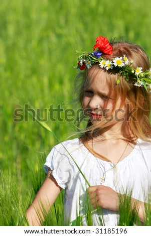 beautiful girl in green field - stock photo