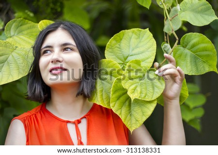 beautiful girl in green leaves . dreamy look - stock photo